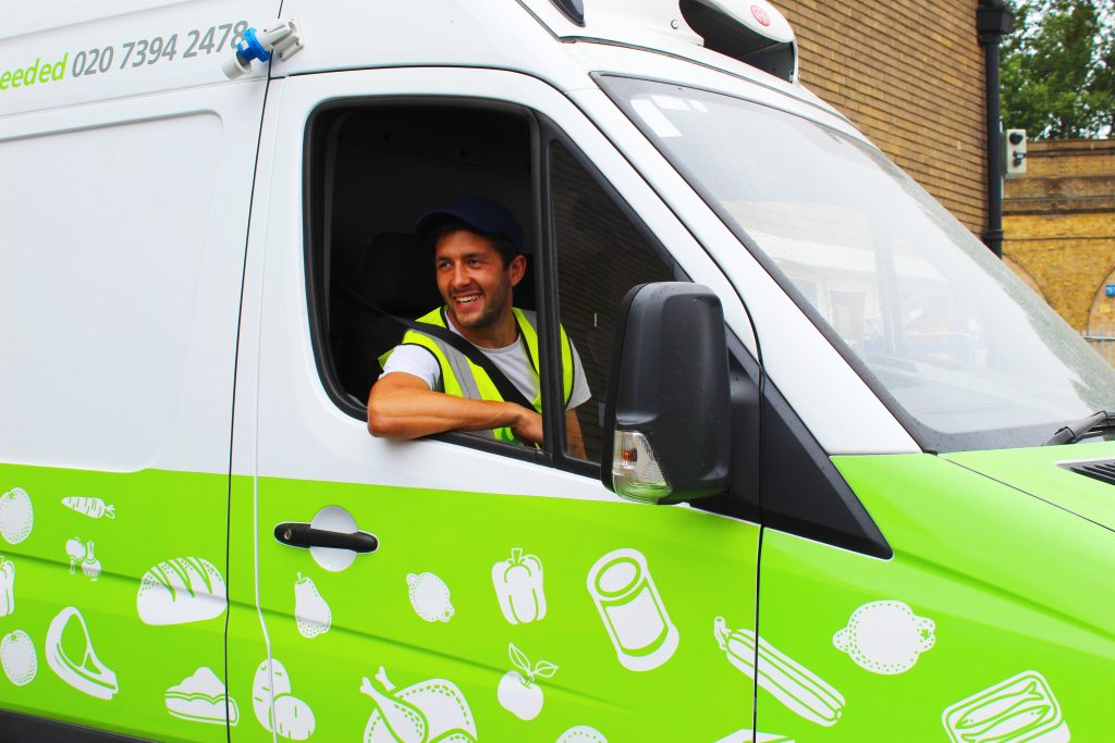 Driver Rory sitting behind the wheel of a FareShare van volunteering