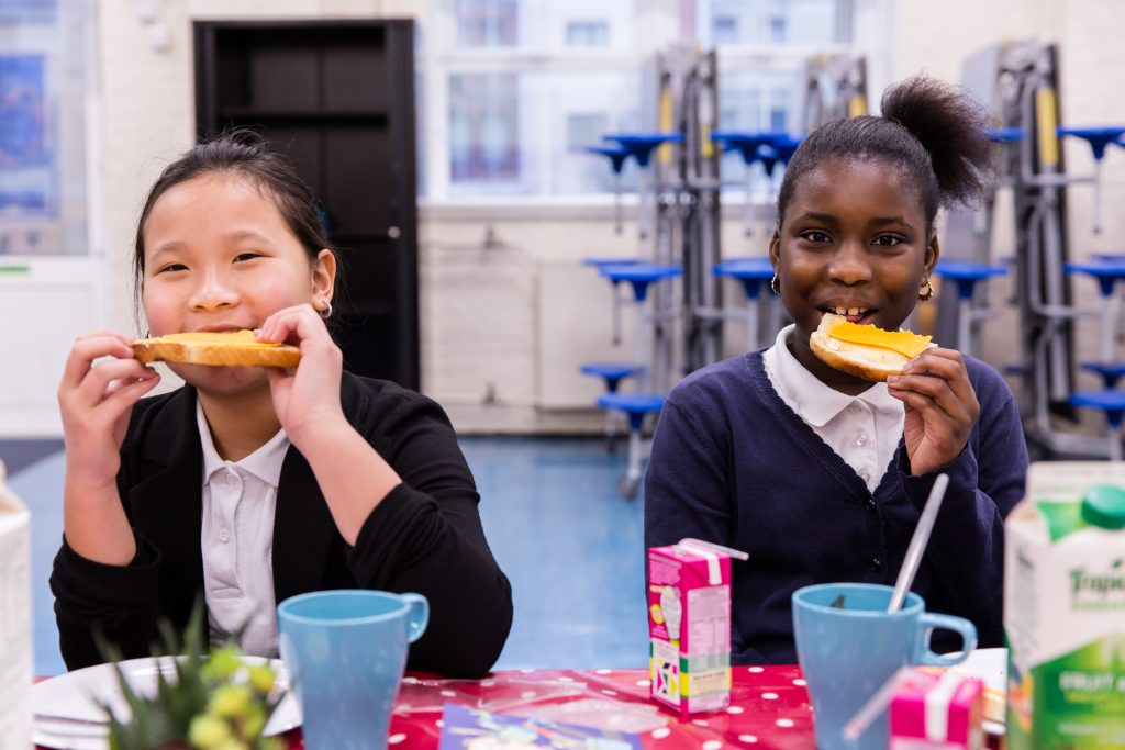 Isabella and Clarissa eat toast at Deptford Park School, 2016
