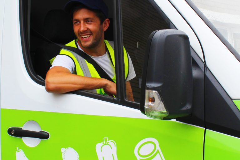 FareShare volunteer driver Rory in a FareShare van delivering surplus food to people in need in London