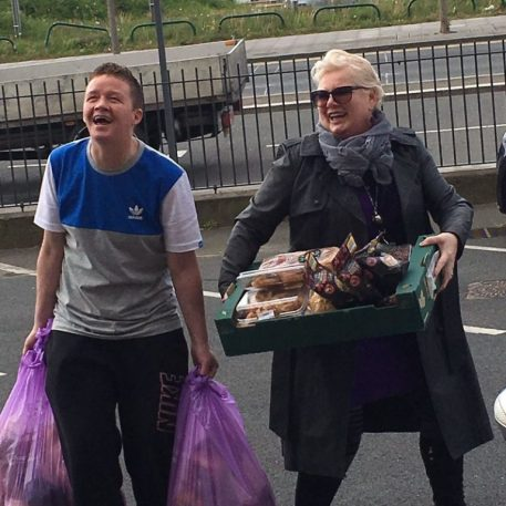 Boy and woman Donating food