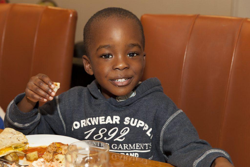 Boy eating FareShare food