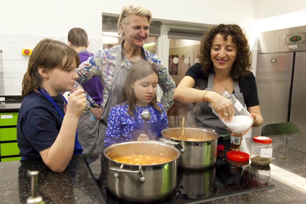 Family cooking together with FareShare food