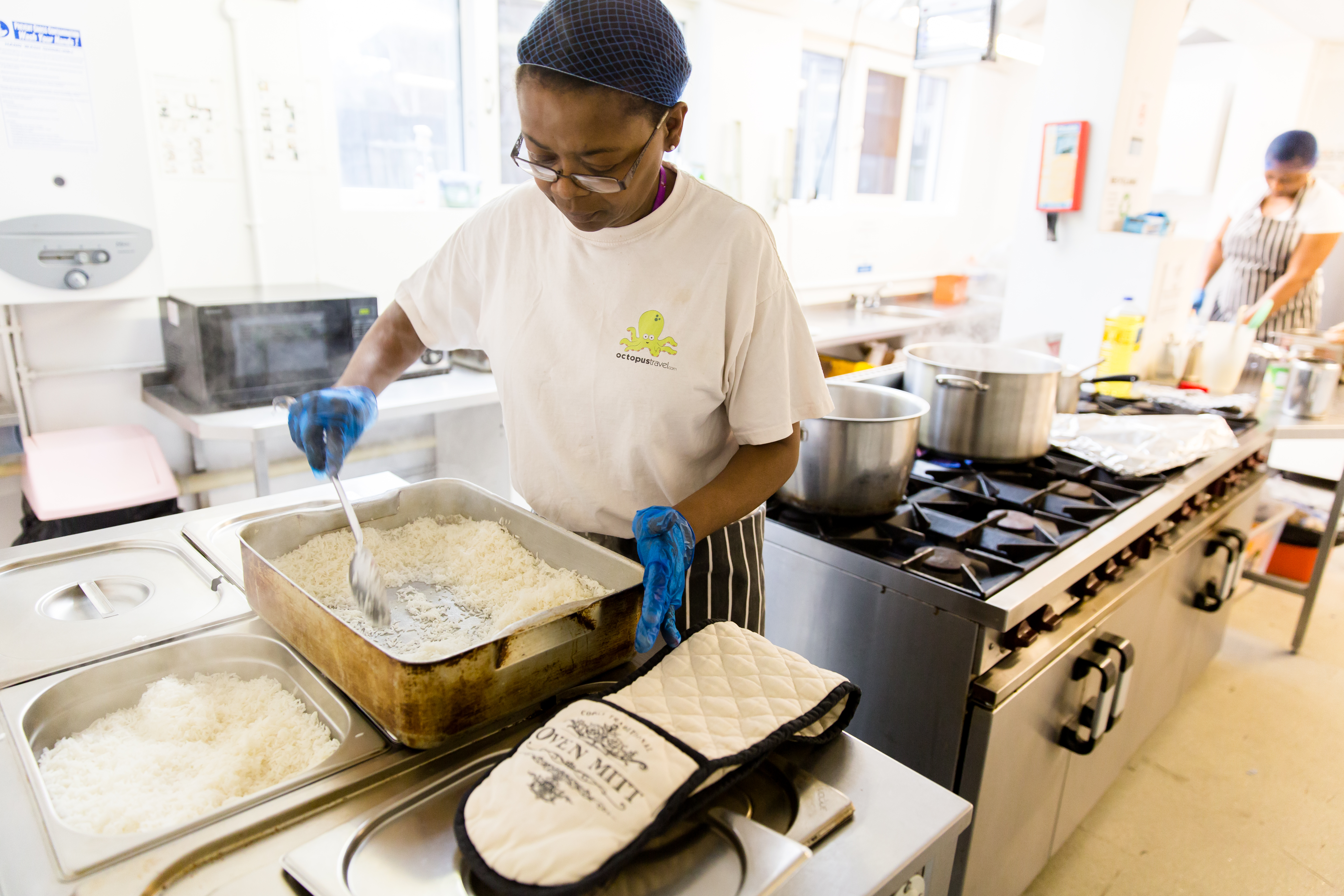 Volunteer preparing lunch for older people at Disabled People's Contact