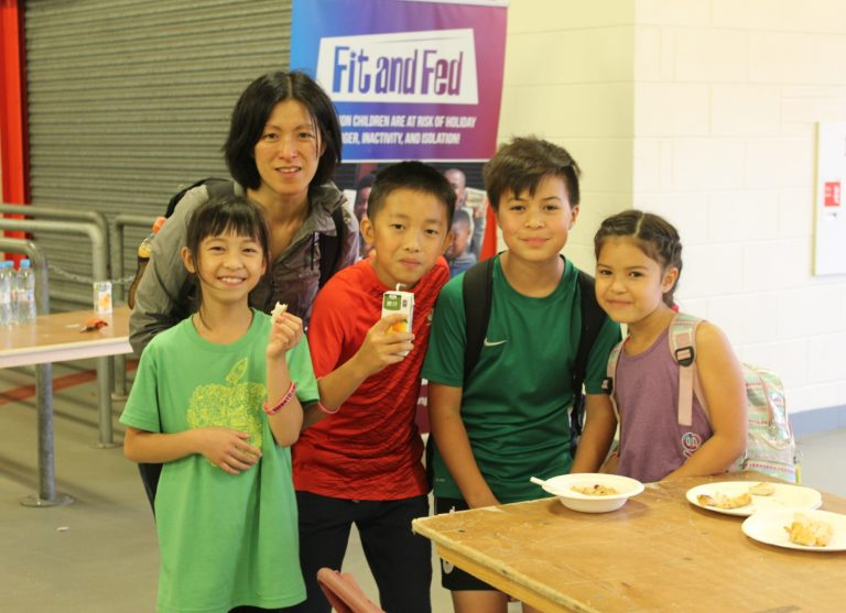 That's a wrap! Children enjoy one of the healthy snacks prepared by volunteers.