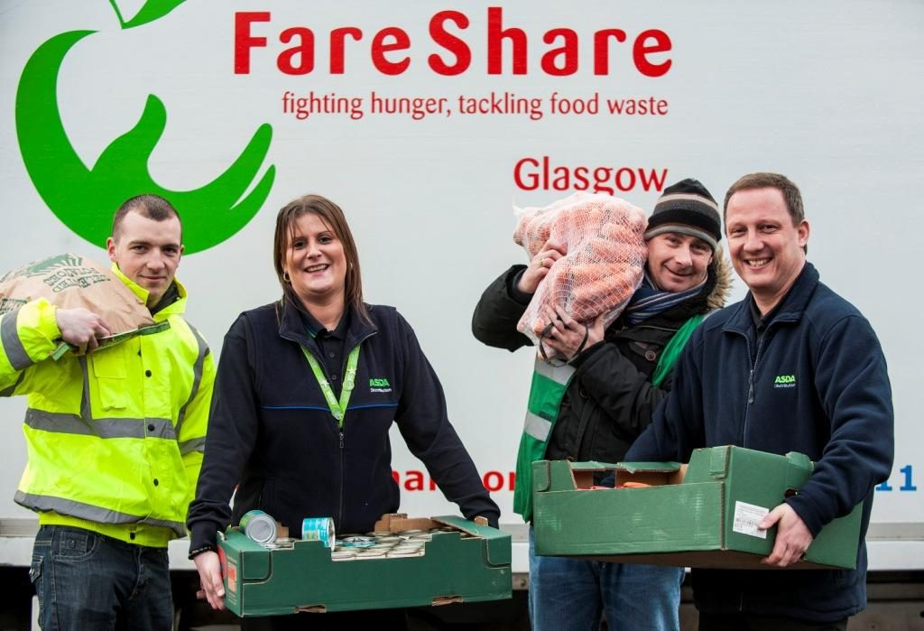 Asda staff holding food next to a FareShare logo