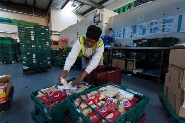Volunteer Mercia sorting sandwiches