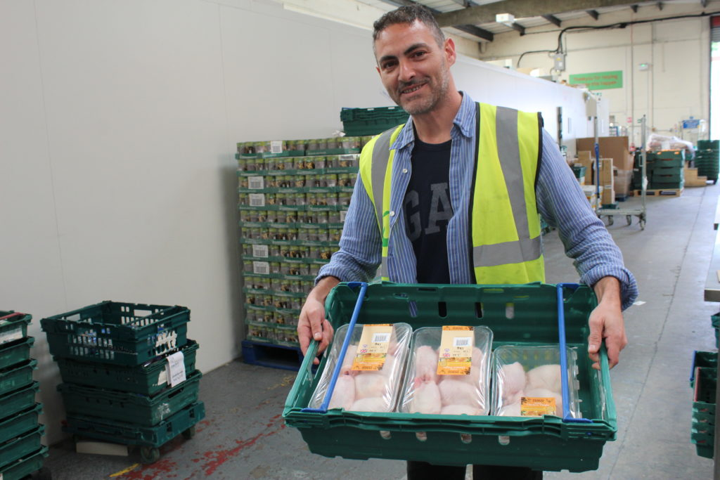 FareShare volunteer with a delivery of surplus chicken from Moy Park