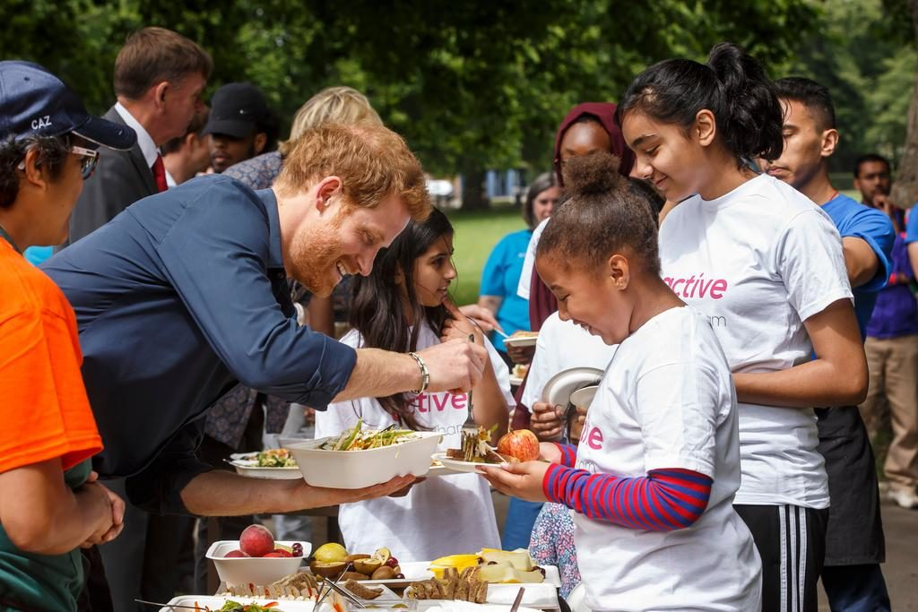 HRH Prince Harry serving lunch at the Newham StreetGames