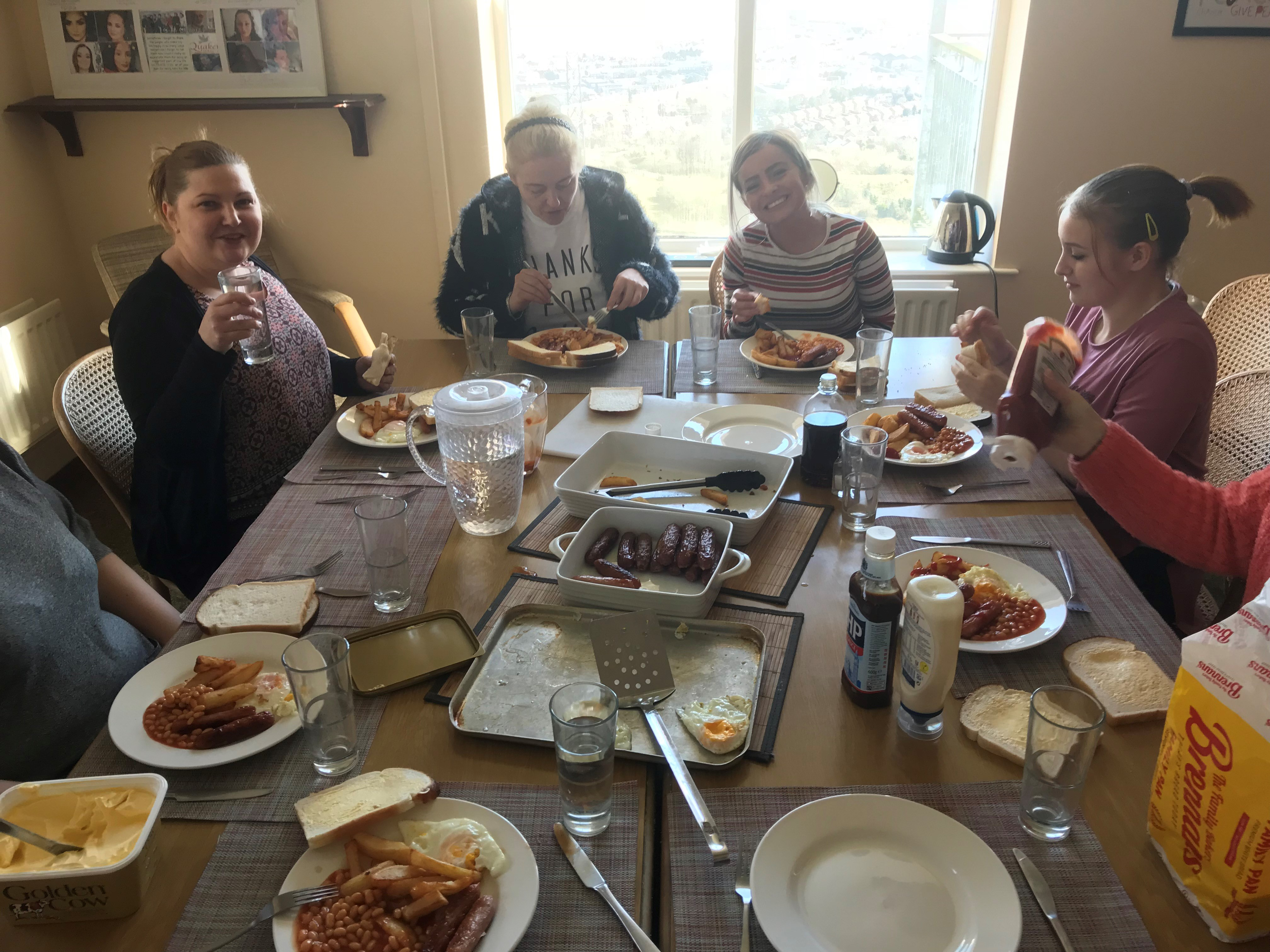 Quaker Cottage service users enjoy lunch for St Patrick's Day