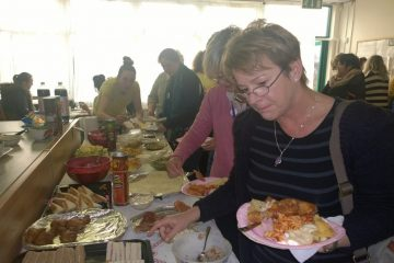Tomorrow's Women Wirral beneficiary enjoying food delivered by FareShare