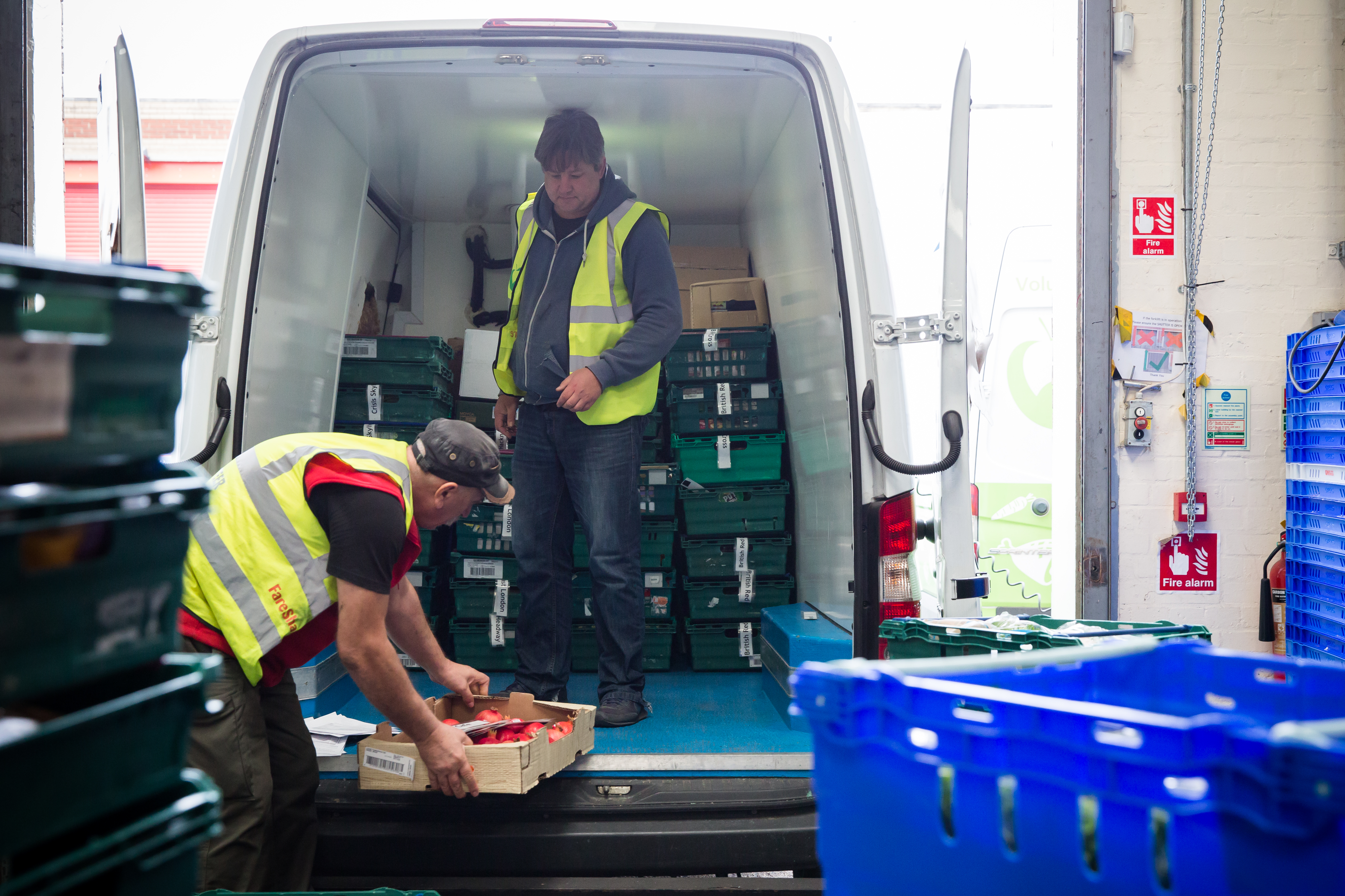 FareShare volunteers loading the van with food